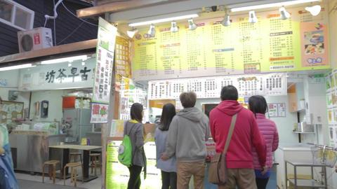 many students walking in shida night market Live Action