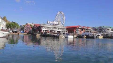 a shot of the quay four restaurant and ferris whee Stock Video Footage