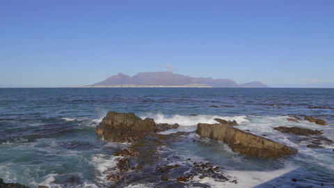 a medium shot of of table mountain and ocean crash Footage