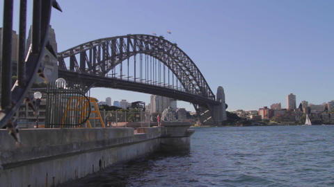 a wide low angle shot of the Sydney harbour bridge Footage