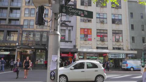 sunny aftertoon in sydney cbd - pedestrians on geo Live Action