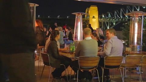 nightlife - people enjoying drinks near the opera  Footage