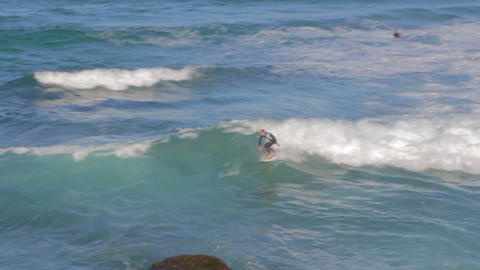 a overhead view of a man surfing the waves at Bron Stock Video Footage