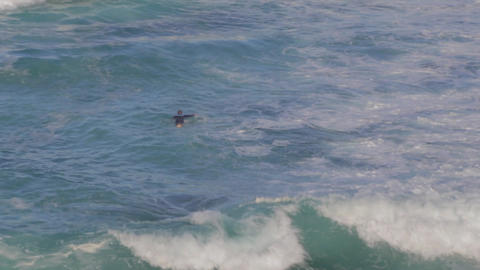 a close overhead view of a man surfing the waves a Stock Video Footage