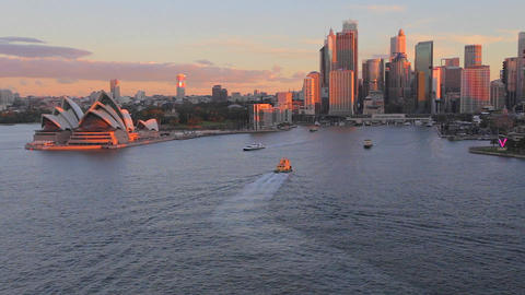 golden hour aerial - sunlight on the opera house, Stock Video Footage