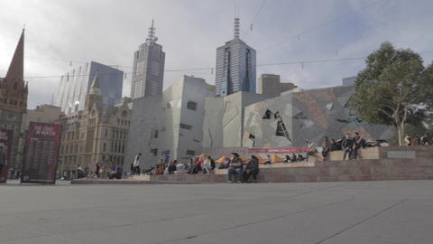 slow wide angle pan of federation square Live Action