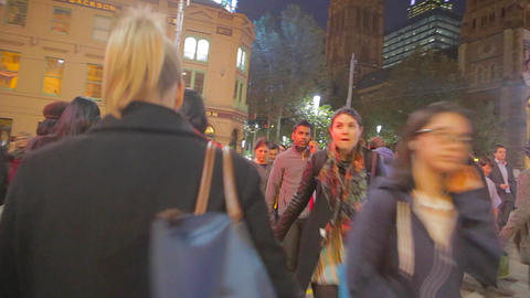 cross the street at federation square with many pe Footage