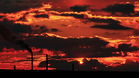 4K. Factory pipe polluting air at sunset. environm Footage