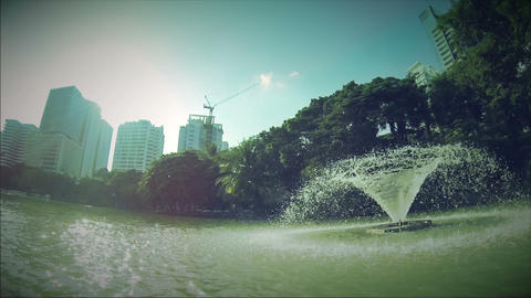 Retro look sail around fountain on lake in Lumpini Stock Video Footage