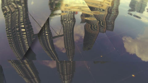 Petronas Towers dancing in the water reflection Stock Video Footage