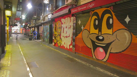 nightlife - unique alley art and pan to people tal Stock Video Footage