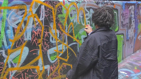 close shot of Boy doing live graffiti at Hosier an Footage