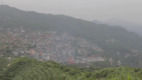 pan of jiufen town from keelung mountain observati Stock Video Footage