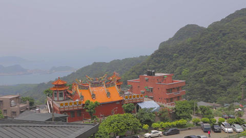 pan of the the jiufen coast line Fushan temple Footage
