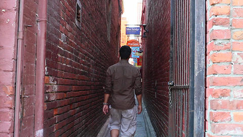 people walking in fan tan alley Footage