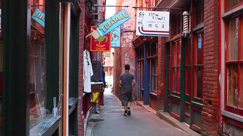 man walks out of fan tan alley Footage