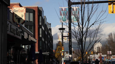 dolly shot - at cambie village mountain background Stock Video Footage