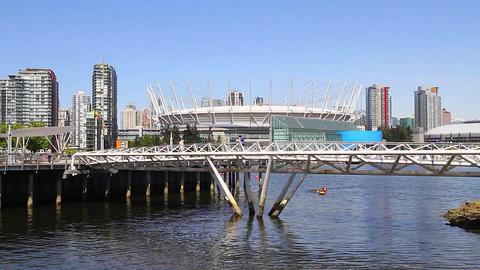 people jogging at olympic village bc place Stock Video Footage