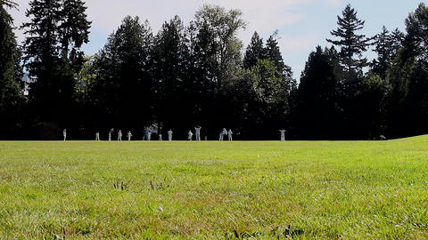 wide shot - cricket players at Stanley park Footage