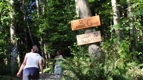 woman starts the grouse grind hike Live Action