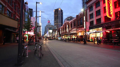 dolly shot - evening Granville street district Stock Video Footage