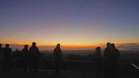 a beautiful pan of a vibrant sunset from the mount Footage