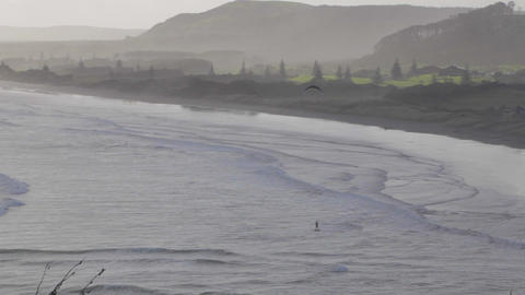 Kite surfer in the air with a mystical trees and m Footage