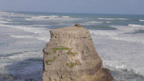 close shot of ocean rock cliff zoomed to wider sho Footage