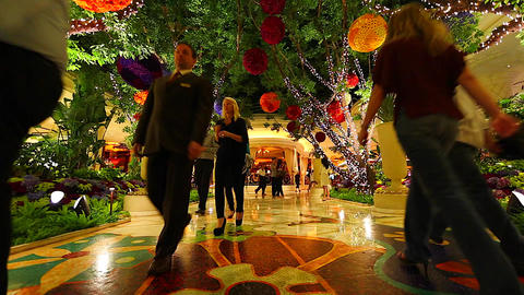 people walking inside the wynn hotel towards the c Stock Video Footage