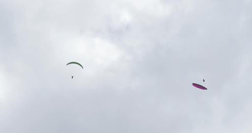 acrobatic paragliding synchro green magenta 32 (4K Stock Video Footage