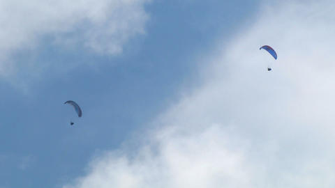 acrobatic paragliding synchro blue 21 Stock Video Footage