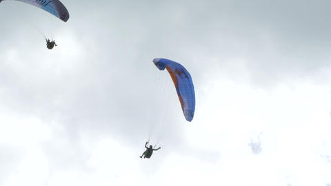 acrobatic paragliding synchro blue 31 Stock Video Footage