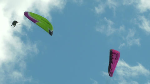 acrobatic paragliding synchro green magenta 33 Stock Video Footage