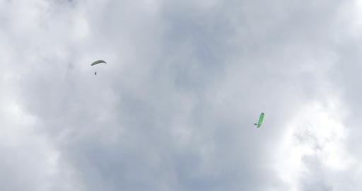 acrobatic paragliding synchro white green 31 (4K) Stock Video Footage