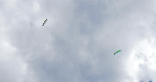 acrobatic paragliding synchro white green 31 (4K) Stock Video Footage
