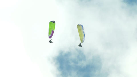 acrobatic paragliding synchro yellow green 32 Stock Video Footage