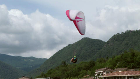 acrobatic paragliding landing 14 Stock Video Footage