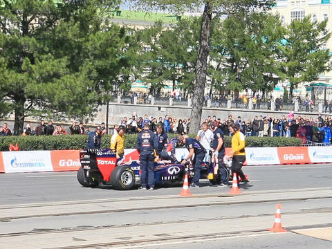 Rider climbs out of a Formula 1 car. G-Drive Show. Stock Video Footage