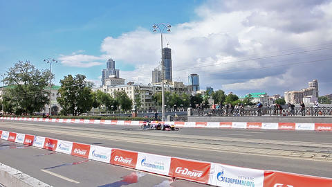 F1 Car Twists On A City Street. G-Drive Show stock footage
