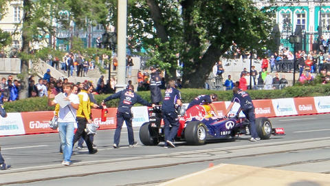 Formula 1 cars are pushing through the city. G-Dri Footage