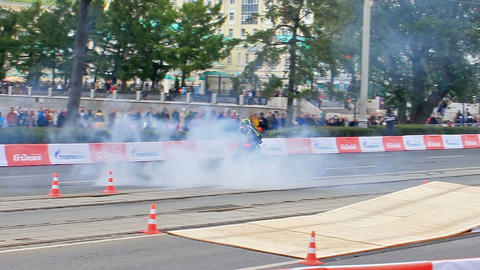 Motorcyclist burning rubber. Motorshow. G-Drive Sh Stock Video Footage