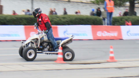 Biker gets up on the bike. Motorshow. G-Drive Show Stock Video Footage