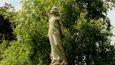 Monumental, statue of a woman without hands on a b Stock Video Footage