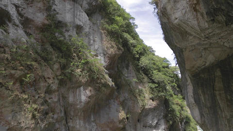 Tilt Of Swallow Grotto Rock Cliffs And Liwu River stock footage