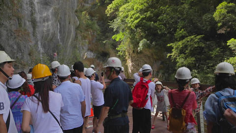 tourists take photos at swallo grotto rock cliffs Footage