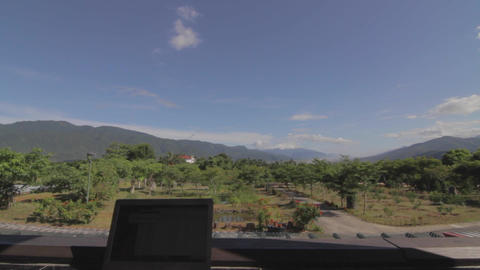 laptop on patio looking at beautiful Rueisuei vist Footage