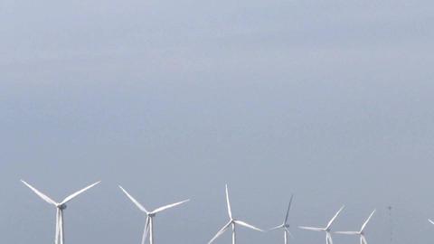 Row of wind turbines generating clean energy Footage