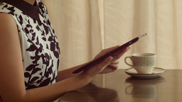 Young Woman Using Tablet Computer at a Cafe Stock Video Footage