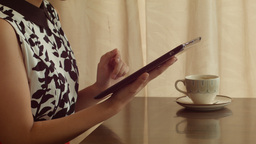 Young Woman Using Tablet Computer at a Cafe Footage