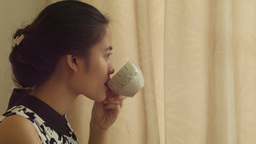 Young Asian Woman Drinking Tea in a Cafe Footage